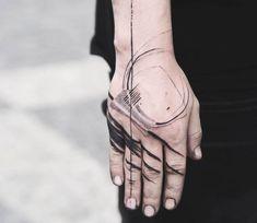 Hand tattoo by Block Tattoo