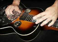 Wooden resonator guitar played with a steel, angled to form a chord unavailable from straight open tuning