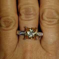 Champagne colored princess cut ring Size 8.5 Sterling silver  Champagne color stone  About 2 CT Clear cz stones on sides of ring Very pretty! Jewelry Rings
