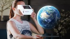 Girl using the Aryzon headset to see the Earth!