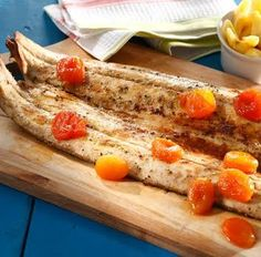 Snoek fish prepared on a grill on wood coals serve with for African fish recipes