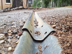 lay round fence posts on driveway for water diversion - Google Search