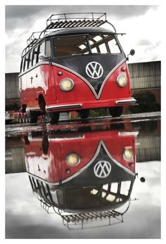 Black and red VW bus with awesome reflection.