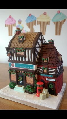 Christmas village frostington post office cake - Cake by Lara Clarke