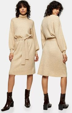 Topshop Oat Knitted Dress. Cosy Winter Knits. Knitted Dresses Winter 2020. How to wear Nudes colours in Winter 2020. Nude Fashion outfits for Winter 2020. Best Knitted Dresses for 2020. Nude Colour Clothes 2020. What to wear for a Winter Wedding 2020. Beige Knitted Dress 2020. Get that premium and luxe look you will just love with our oat funnel neck knitted jumper dress with exaggerated sleeves and belted detail. This midi contains wool fabric for that cosy autumn feel and look.