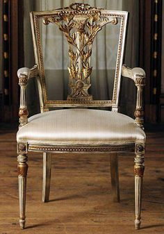The gold ornamentation on this chair suggests Baroque, as well as the square shape of this chair. They were large and square in this period. Baroque also fancied shells and plants as decoration.