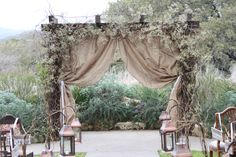 On a smaller scale, of course.burlap curtains for altar, lanterns for aisle markers Rustic Wedding Backdrops, Rustic Wedding Guest Book, Barn Wedding Venue, Wedding Gazebo, Wedding Bells, Coral Wedding Flowers, Tulip Wedding, Altar Decorations, Wedding Decorations