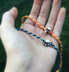 Quiet Lion Creations: Vanities-Tiny Skull Bracelet    good tips on twisting threads to make a thick spiral string