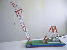 This paper model is a Crane Vessel (Crane Ship or Floating Crane) Yosho, a ship with a crane specialized in lifting heavy loads, the papercraft is created by a Japanese designer.