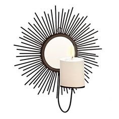 Simply Chic Sunburst Wall Candle Holder Black - Brighten up the dull and boring ambience of your living room with this black coloured wall candle holder. Classy and stylish, this candle holder will not fail to leave a lasting impression on your guests.