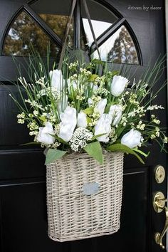 Take a flat-backed basket and fill it with floral foam and flowers for the perfect spring door decoration