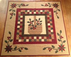 Veronica Longobardi What a cheery holiday quilt - love the basket of holly! Really cool pieced stars married to appliqued vines in the cor...