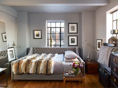 Wooster's bedroom is all about comfort. Fur blanket by Fur Source. Industrial lighting by Restoration Hardware.