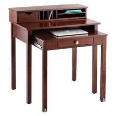 Our handsome Solid Wood Roll-Out Desk is a great solution for high-traffic areas and for use as a bill-paying area. When it's time to get to work, simply pull out the lower part of the desk - it's on wheels for smooth gliding action. The generous work surface gives you plenty of space for computing or writing. When not in use, the lower section rolls back into the desk for space efficiency.