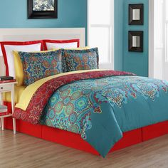 The vibrant Terra Comforter Bedding from Fiesta(R) will create a global fashion bedroom. Oversized comforter has two cotton faces and is completely reversible. On face is predominantly blue and the other face is predominantly red. Big and small medallions with contrasting blues, reds, and oranges with hints of yellow adorn the fabric.