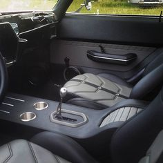72 chevelle custom interior. black and grey. door panels console fabrication grommets