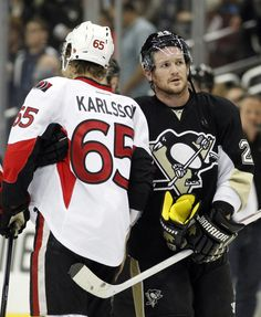 Karlsson and Cooke in the handshake line