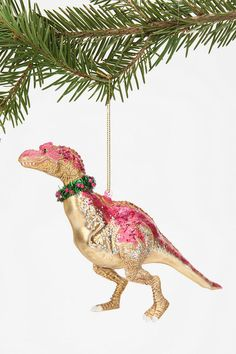 nothing says Christmas like this dinosaur ornament--urban outfitters.