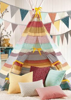 Looking for the perfect weekend project? Make this DIY Striped Fabric Teepee for your kids!