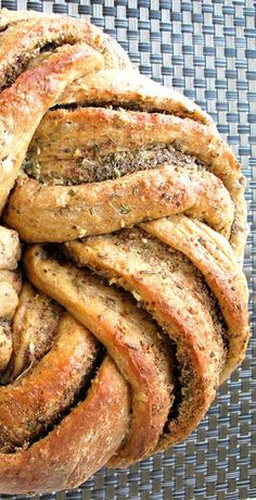 Rosemary Garlic Flaxseed Kringel Bread Recipe ~ It's an impressive-looking bread once it's baked, but don't be scared off thinking you can't make it as it's really quite simple to shape
