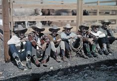 1928 San Antonio, Texas - Cowboys and riders sit along a fence at the Rodeo. IMAGE: CLIFTON R. ADAMS/NATIONAL GEOGRAPHIC CREATIVE/CORBIS