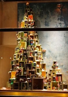 ANTHROPOLOGIE | Create a large tree using boxes to display products and holiday items in your from window. Practical and impactful. #windowdisplay