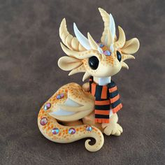 Freckled-Orange-Scarf-Dragon-Sculpture-by-Dragons-and-Beasties