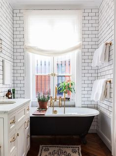 white tiles black bath