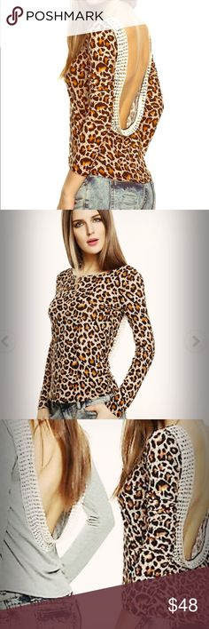 NWT✖️Leopard Print long sleeve top with lace back New With Tags ✖️🌹🕯One medium size top - super cute long sleeve leopard print sexy chic top with an open lace trim back ✖️NO TRADES ✖️ Could fit a small or medium ✖️Offers welcome or bundle for discounts ! the Haute Holly-Would Hive LLC Tops Tees - Long Sleeve