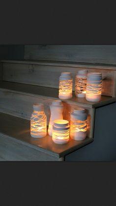 DIY Spray Painted Lantern. Wrap ribbon around a thrift store glass or mason jar and spray! #diy #spraypaint #lanterns