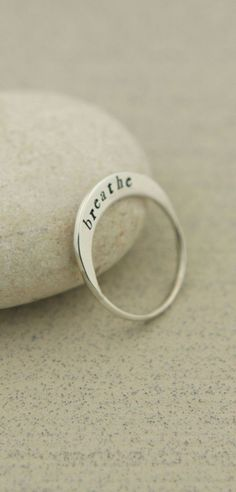 "A lovely little crescent sits atop your finger when your wear this sleek oblong ring of sterling silver. Engraved with the word, ""Breathe,"" it will bring you to a place of relaxation and centeredness…MoreMore #SilverJewelry #engravingsterlingsilverjewelry"