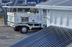 Getting of the grid from fossil fuels in transportation with this electric Piaggio Porter with hydrogen fuel cells on board and a photovoltaic roof (forbidden!) behind an Off Grid Box at Hydrolab.