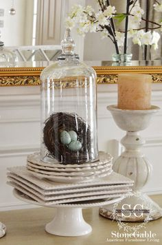 I like the way this cloche is set on top of a stack of plates rather than just one plate. From StoneGable.