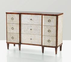 A LACQUERED WOOD, EGGSHELL AND SILVERED BRONZE CHEST OF DRAWERS BY MARCEL COARD, CIRCA 1936