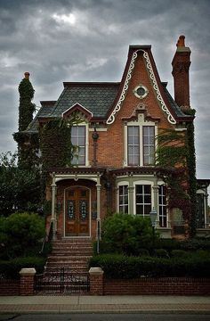 Victorian House with brick and a mansard roof