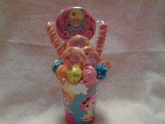 One made to order Lalaloopsy Lollipop Bouquet. The perfect gift idea or great table centerpieces or guest gifts at your next Lalaloopsy Birthday Party.  **Lollipops are all edible** **Cups are reusable** **Discounts given for multiple ordered