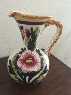 I fell in love with this piece the moment I laid eyes upon it. The braided handle and unique shape are beautiful. It's very heavy. Another find in Germany.