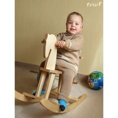 Cute eco-friendly rocking horse! | Eco Style Round-Up: Warm Baby Accessories For Cold Weather Comfort Wood Kids Toys, Baby Warmer, Baby Accessories, Rocking Chair, Cold Weather, Hand Carved, Eco Friendly, Horse, Carving