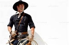 cowboy wearing western clothing holding a lasso