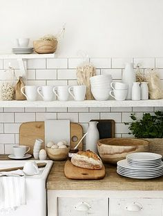 a useful kitchen that is used -- open shelves, butcher-block counters, subway tile, and I'll take the loaf of bread, too