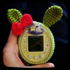 Tamagotchi crochet  cover with rabbit ear and bow by Muninahandmade on Etsy