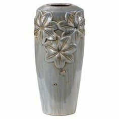 """Ceramic vase with a soft gray-blue finish and floral detail.  Product: VaseConstruction Material: CeramicColor: Gray-blueDimensions: 16.5"""" H x 8"""" DiameterCleaning and Care: Wipe clean with a dry cloth"""