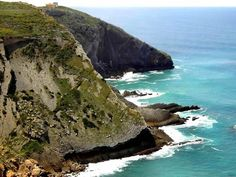 The Romans named it Promontory barbaric, alluding to its dangerous location, and a lighthouse warns sailors of the treacherous rocks below. Portugal Travel, Spain And Portugal, Cabo Espichel, Portugal Places To Visit, Sea Activities, Sunny Beach, Natural Park, Fishing Villages, Folk
