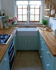 L'aménagement d'une cuisine en U réussi grâce à la règle du triangle d'activité