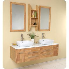 A natural wood finish highlights this Fresca Bellezza modern bathroom vanity. This double-sink vanity features two mirrors and two Fresca Tolerus faucets.