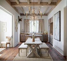 Another bull mounted high overhead. Interior Design by Annelle Primos. Photo by Chipper Hatter via here.
