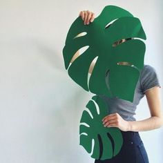 Daydreaming of being somewhere tropical and sunny with these giant paper leaves for our window display, inspired by our latest blog post  #Cambie #Design #CambieBlog
