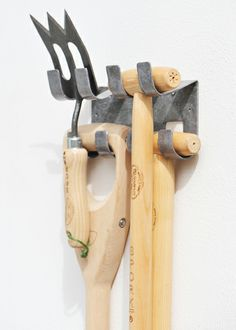 Tool hook system - designed to take a  'D' or 'T' shaped tool handle - Neatly hanging, saving space.