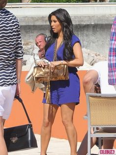 kim kardashian in monte carlo monaco memorial day outfit purple romper on yacht 2011