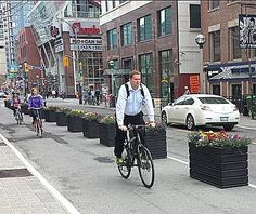 Toronto bike lane protected by planters. Visit the slowottawa.ca boards >> http://www.pinterest.com/slowottawa/boards/